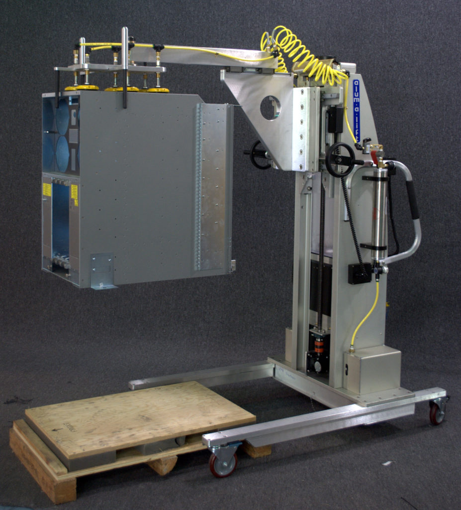 Vacuum Lift with Guide Probes Raising Electronic Assembly from Pallet
